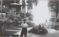 Городской сквер, круглая беседка и фонтан. На заднем фоне улица Героев. г. Холмск