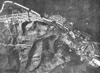 Вид с самолета на город Эсутору. Сплав леса по реке.