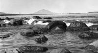 Вид острова Кунашир. На горизонте вулкан Тятя